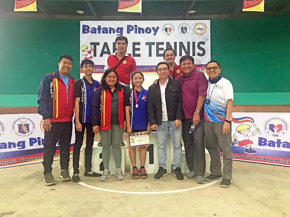 Batang Pinoy champion Micah Tanate with Reverend Hosea Alvarez, George Saligumba, Coach Marell Lagunday, PTTF president Ting Ledesma, former PSC commissioner Jolly Gomez, Samuel Sacopla, and Boy Verba. (Contributed Photo)