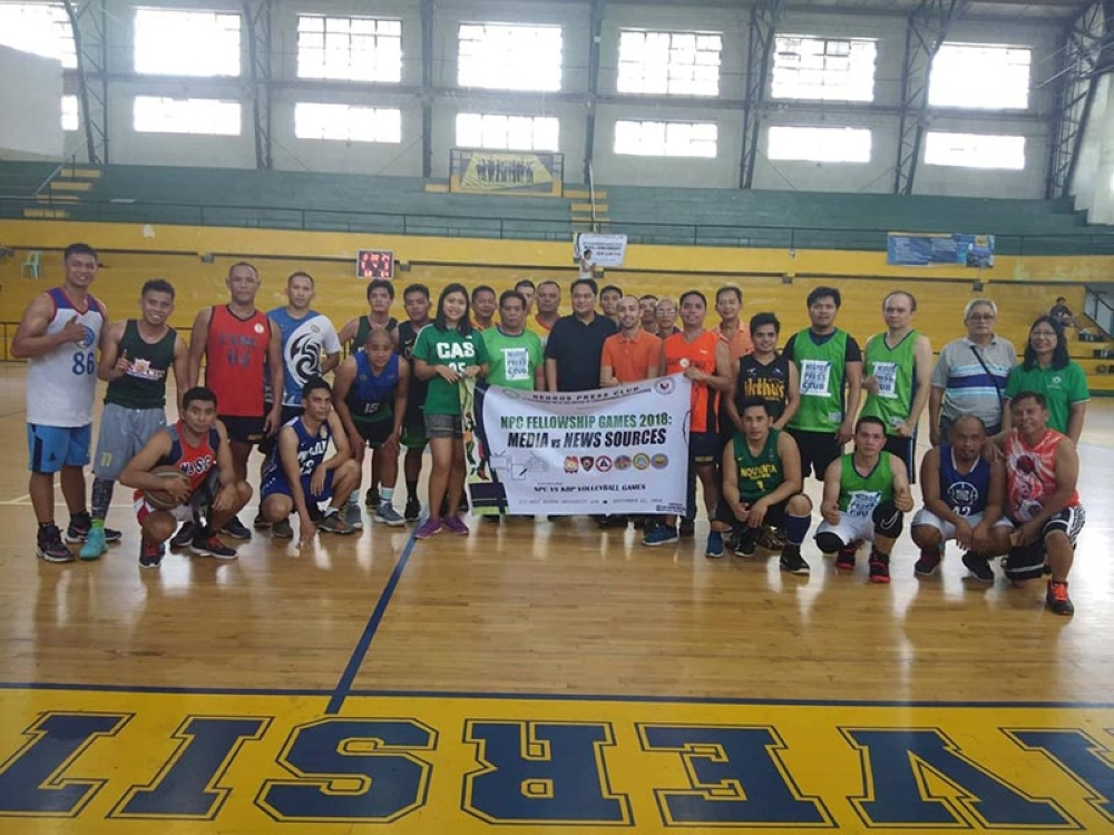 Players from the Negros Press Club (NPC) and News Sources Team with Bacolod City Representative Greg Gasataya and NPC president Renato Duran during the NPC Fellowship Games 2018 held at the STI West Negros University gymnasium in Bacolod City Saturday, September 22. (Glazyl Masculino)