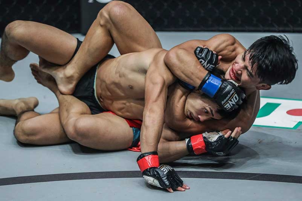 INDONESIA. Vastly improving their ground game, Danny Kingad of Team Lakay tries to submit Yuya Wakamatsu in their flyweight match at ONE: Conquest of Heroes in Jakarta, Indonesia on September 22. (ONE Championship photo)