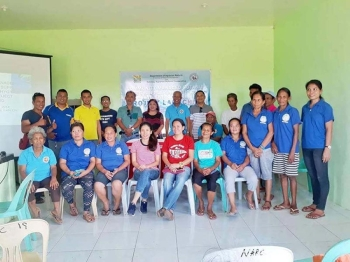Cadiz City Cooperative Development Council Head Shen Villena (standing, fifth from left) with DAR-Negros Occidental personnel led by Enterprise Development and Economic Support chief Teodoro Che Salido (standing, fourth from left) and farmer-members of Nabinay Agrarian Reform Cooperative during the launching of the potable water source project at Barangay Daga in Cadiz City on Friday. (Contributed Photo)