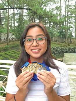 MULTIPLE GOLD MEDALIST. Former Davao City standout Zoe Marie Hilario poses with her four gold medals and one silver won in the Batang Pinoy 2018 National Championship in Baguio City recently. (Contributed photo)
