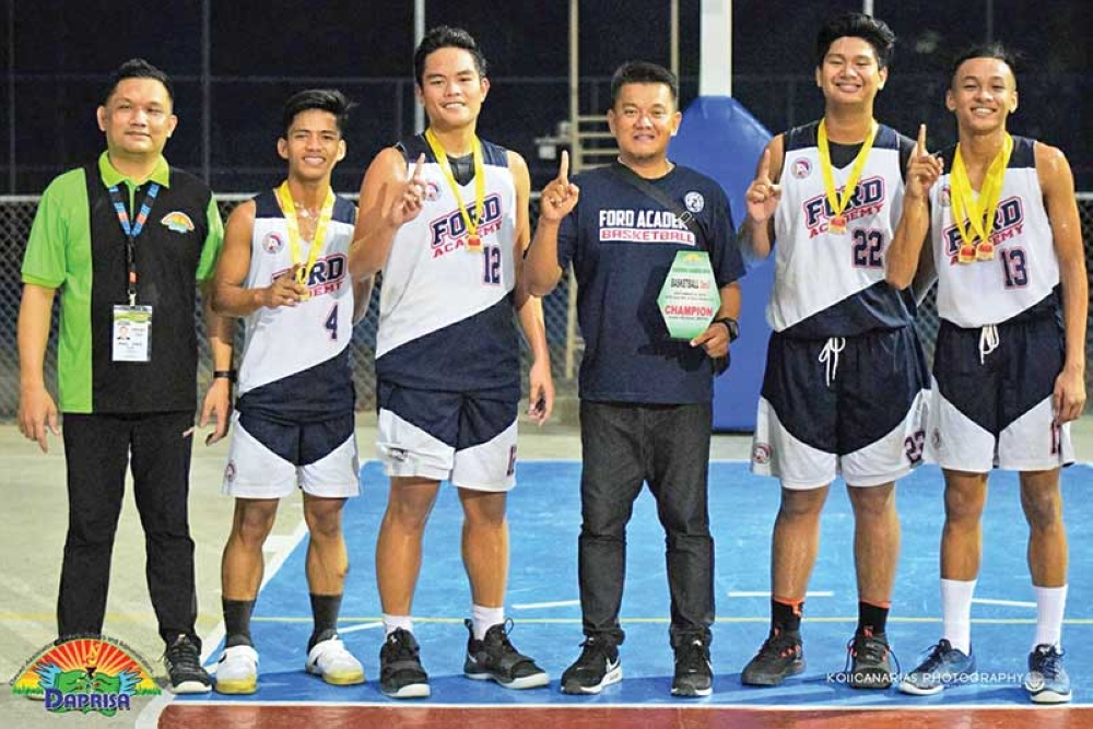 DAVAO. Ford Academy of the Arts (FAA) players and coach celebrate their gold medal victory in the  Davao Association of Private Schools and Administrators Inc. (Daprisa) Games 2018 secondary 3x3 basketball finals held at the Doña Pilar Learning Center Foundation (DPLCF) covered court Monday evening, September 24, 2018. Also in photo is tournament coordinator Rael Diaz. (Photo by Koii Canarias)