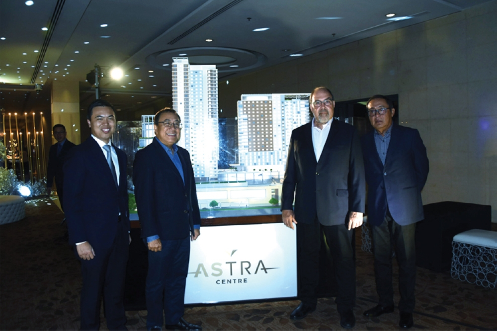 Astra Centre Launch. Posing beside the project model are from left, Cebu Landmasters chief operations officer Jose Franco Soberano, chief executive officer Jose Soberano III, executive vice president Norman Garden of design consultant RTKL and architect Rolando Mercado.