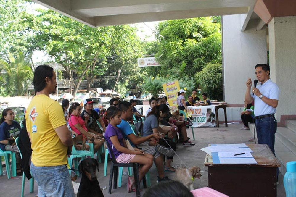 BACOLOD. Provincial Veterinarian Renante Decena (right) leads the information and education campaign among dog owners at the Provincial Veterinary Office in Bacolod City in March this year. (Contributed Photo)