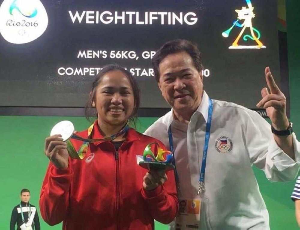 Asian Games weightlifting gold medalist Hidilyn Diaz and Samahang Weightlifting ng Pilipinas president and former Bacolod mayor Monico Puentevella.  (SunStar file photo)