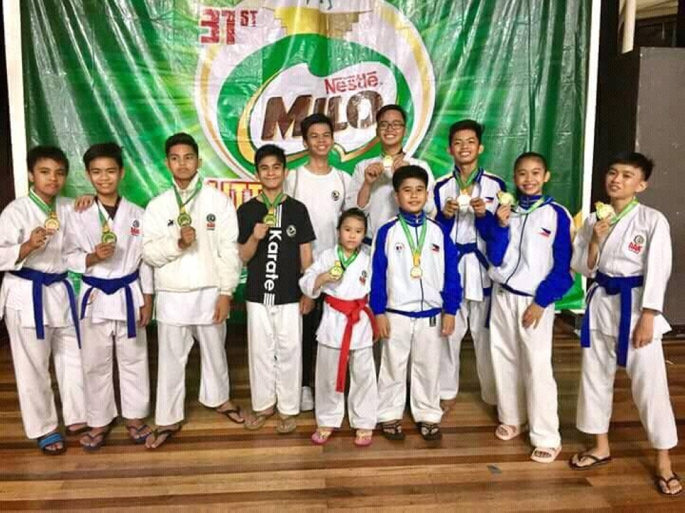 CAGAYAN DE ORO. Association for the Advancement of Karate (AAK) Davao members pose during their awarding ceremony of the 31st Milo Little Olympics Mindanao Leg held at the Limketkai Atrium in Cagayan de Oro City over the weekend. (Photo by Rommel Tan)