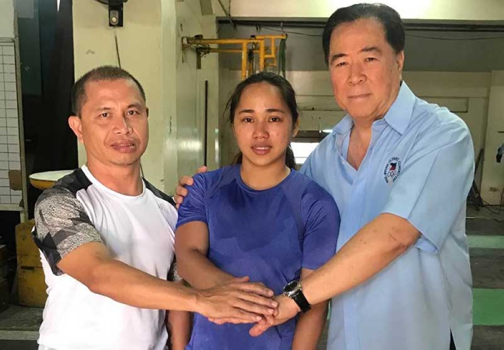 BACOLOD. Weightlifting coach Tony Agustin (left), 2018 Asian Games weightlifting gold medalist and Rio Olympic silver medalist Hidilyn Diaz (center) and Samahang Weightlifting ng Pilipinas (SWP) president Monico Puentevella (right) following a meeting Thursday morning. (Contributed Photo)