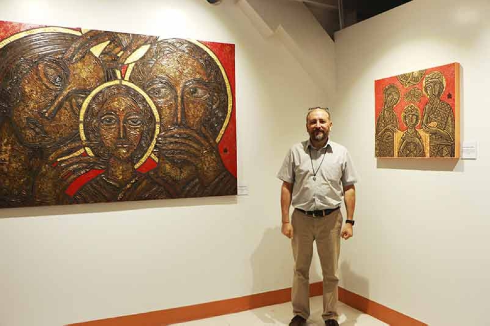 DAVAO. Bro. Edgardo Hugo Campos, a member of the Brothers of the Holy Family, uses his artistic gift in his evangelization work. (Contributed photo)