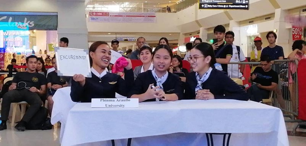 TOURISM QUIZ BEE. Tourism students of Phinma Araullo State University smile as they earned points from the clincher round at the 2nd Central Luzon Tourism Quiz Bee on Thursday at Robinsons Starmills. (Nicole Renee David)