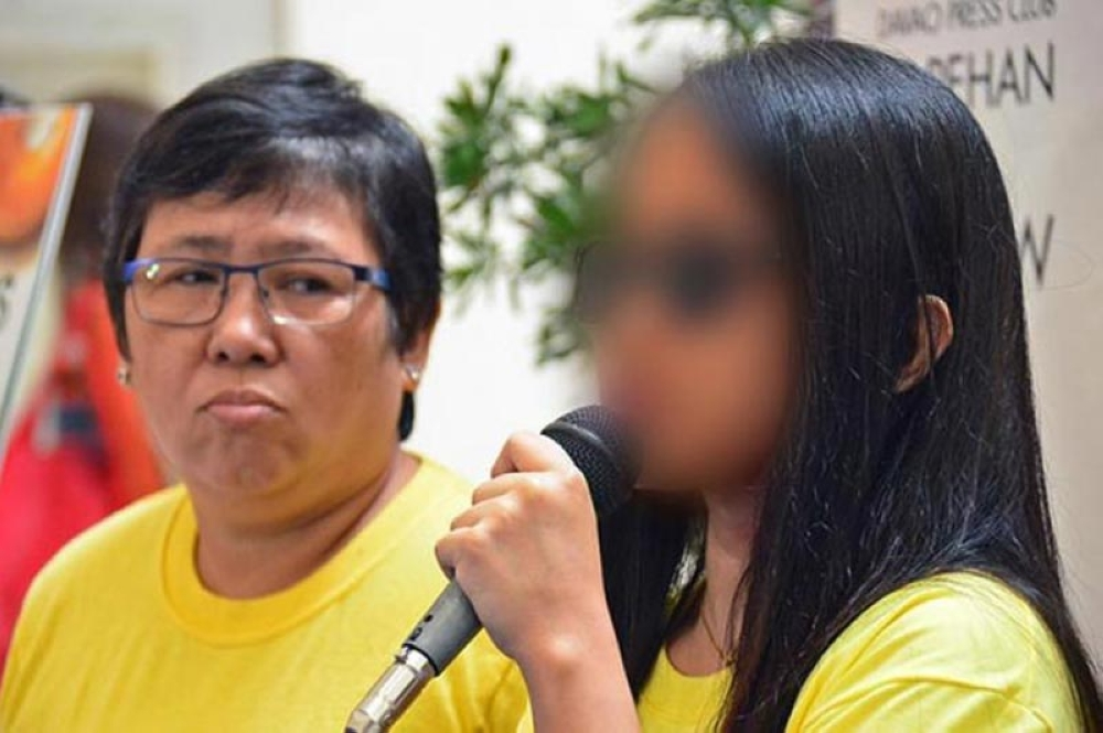 TRAFFICKED VICTIM. Talikala-Davao executive director Jeanette Ampong together with a victim whom they have assisted during a press forum. The latter shared what she has gone through before she was rescued. (Macky Lim)