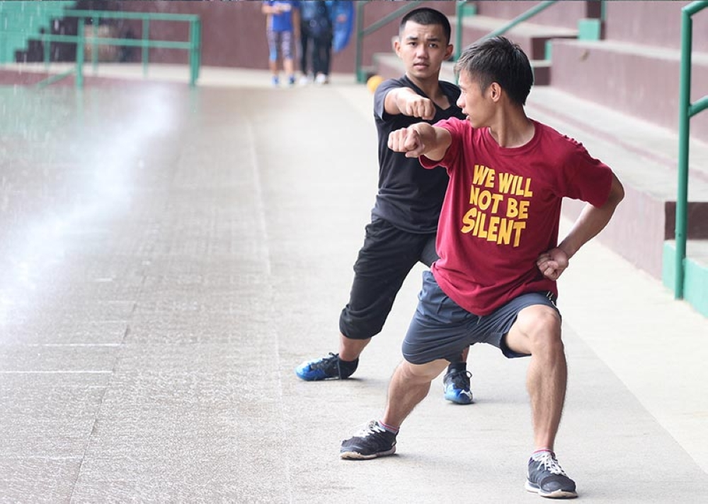 BAGUIO. Wushu athletes train at the athletic bowl in preparation for the upcoming Baguio-Benguet Educational Athletic League. Aside from wushu, other combative sports remain one of the city's top medal producer in national and international competition as the PSC announced Baguio will be a regional sports training center. (Jean Nicole Cores)