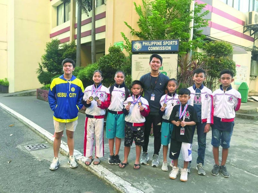 SUCCESS. The Cebuano taekwondo jins show off their medals after winning in a national tournament in Manila. (Contributed photo)