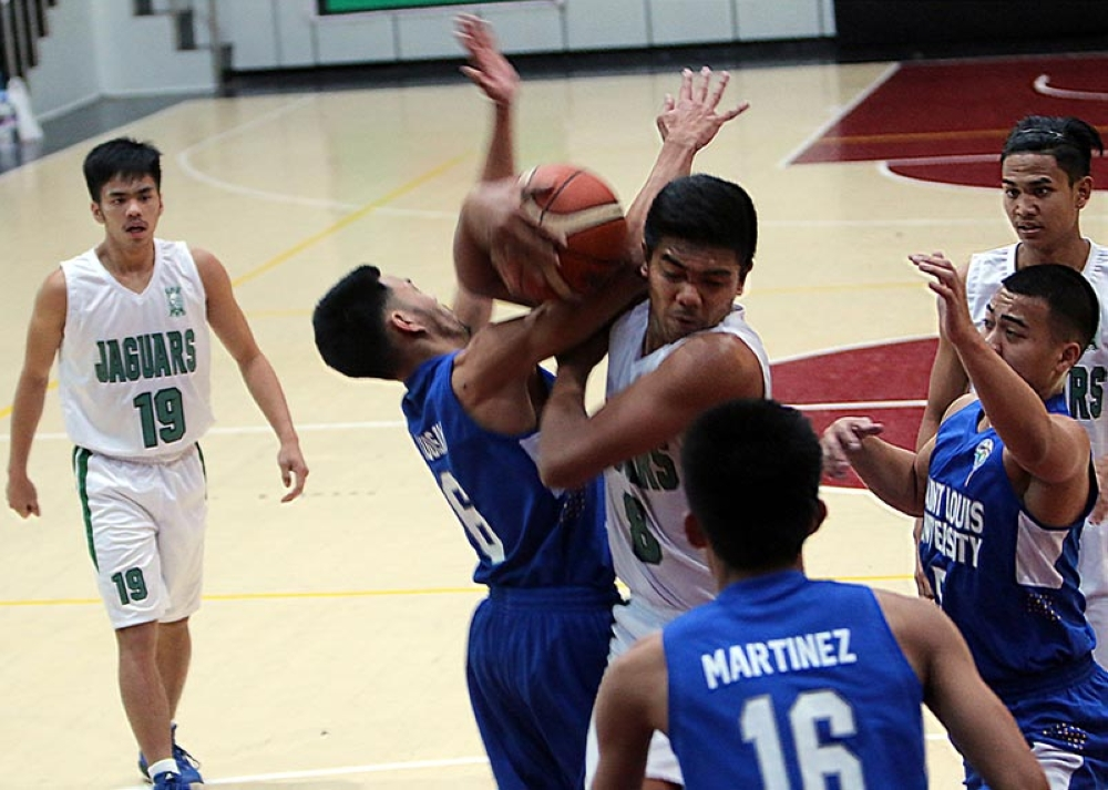 BAGUIO. In this 2017 file photo, UC Jaguars center Krenz Trinidad scrambles for the ball against the SLU Navigators during their semifinals match. With Trinidad already graduating for the Jaguars, the defending champion needs to fill the gap left by the forward in their quest for a grand slam when the 32nd season of the BBEAL opens. (SSB File Photo)