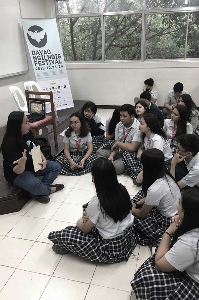 Angely Chi, DNF 2018 Film Camp director, giving talks on filmmaking to Grade 11 and 12 students of the Ateneo de Davao University. (Contributed photo)