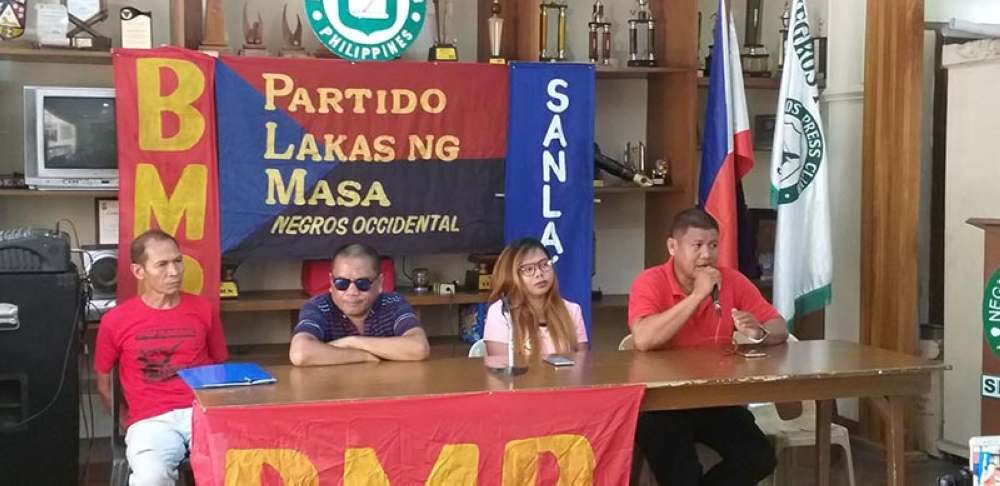 BACOLOD. Angel's Burger Crew Workers Union president Riches Mahilum (2nd from right) with leaders of Bukluran ng Manggagawang Pilipino and Kilusang Mayo Uno in a press conference the Negros Press Club in Bacolod City on Friday. (Erwin Nicavera)
