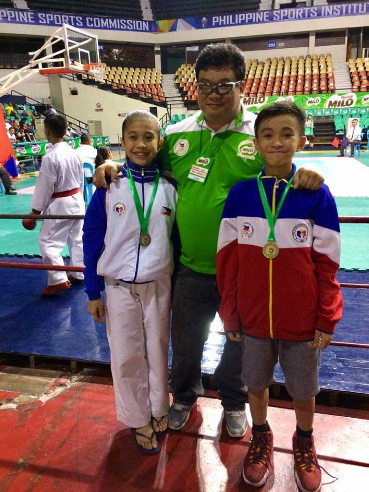 Kyzzhia Pauline Navarro, left, Karate Pilipinas regional director Rommel Tan and Aldren Solon pose with their medals during the 1st Karate Pilipinas Cadet's and Children's Championships held at the Philippine International Convention Center (PICC) in Pasay City, Metro Manila. (Ceth Barbadillo photo)