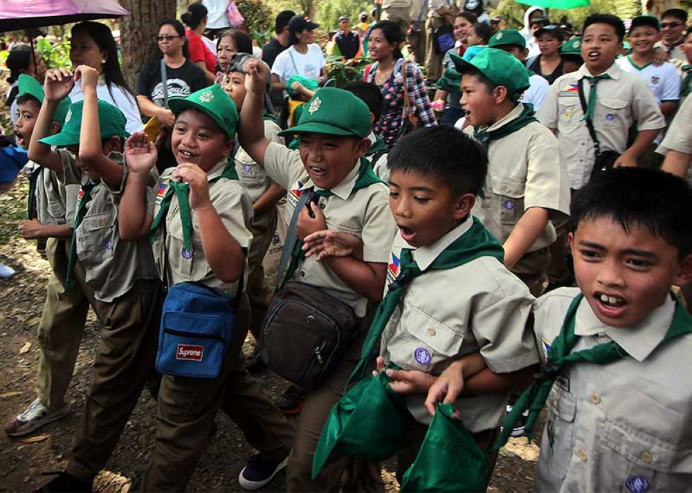 """BAGUIO. Boy scouts in Baguio City march down the main thoroughfares of the city during a parade. Members of the scouting community """"unseated"""" officials for a day and ran the affairs of the different local government units in the city and Benguet province on October 8, 2018. (Photo by Jean Nicole Cortes)"""