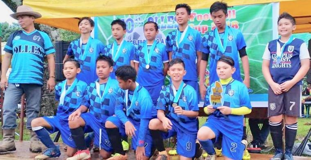 CAGAYAN DE ORO. Corpus Christi FC led by MVP awardee Sam Salingay (standing third from right) during the awarding ceremony in the 10 Olles Cup Football Festival. (Contributed photo)
