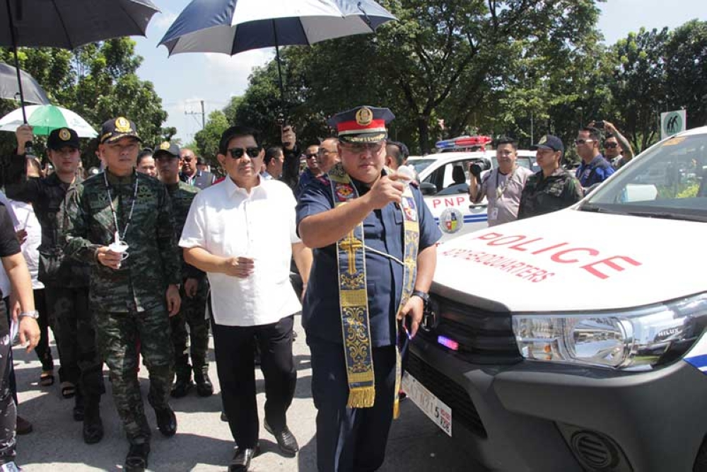 POLICE VEHICLES. Angeles City Mayor Edgardo Pamintuan and PNP Director General Oscar Albayalde led the blessing of new patrol vehicles for the Angeles City Police Office. (Contributed Photo)
