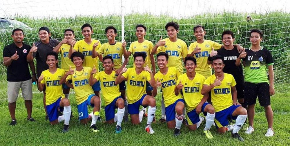 STI-West Negros University Junior Mustangs after defending their Nopsscea secondary boys' football title against UNO-R. (Jethier Escobar)
