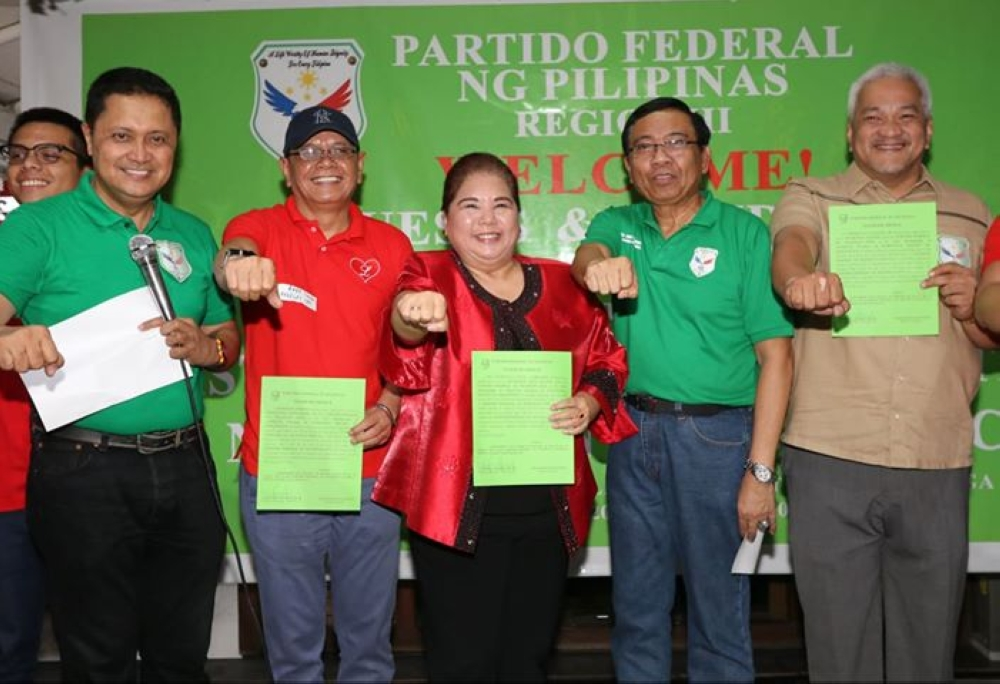 ANGELES. Angeles City mayoralty aspirant Councilor Carmelo Lazatin, Jr. (L), running mate former Vice-Mayor Vicky Vega-Cabigting (C) and former Councilor Rudy Simeon (2nd, L) Partido Federal ng Pilipinas National Chairman Abubakar Mangelen and PFP-Central Luzon Chairman and comebacking Capas Mayor Antonio Rodriguez during Tuesday's Oath Taking and Distribution of Cona at Matam-hi, Clark Freeport. (Chris Navarro)