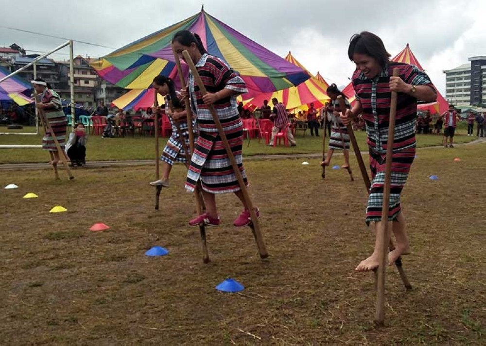 BAGUIO. Teachers garb in their traditional attire compete in kadang-kadang, a traditional Filipino game conducted on October 8 at the Wangal Sports Complex in La Trinidad, Benguet. (Photo by Lauren Alimondo)
