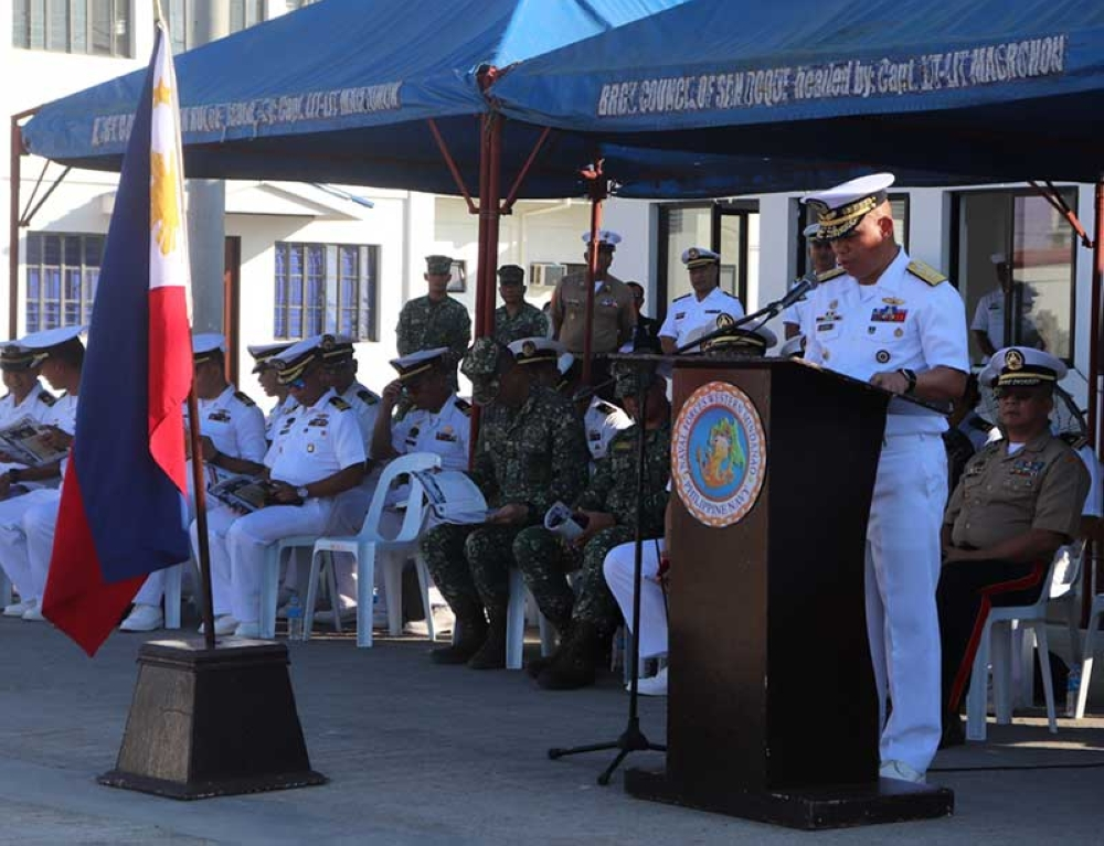 ZAMBOANGA. A photo handout shows Rear Admiral Rene Medina, Naval Forces Western Mindanao commander, reading the activation order of the Naval Station Rio Hondo. The new Navy Station was activated on Tuesday, October 9. (Bong Garcia)