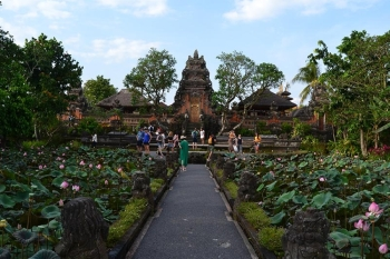 (From front) BALINESE TEMPLE. The Pura Taman Saraswati Temple features classical Balinese temple architecture and a foyer featuring ponds with pink lotuses.