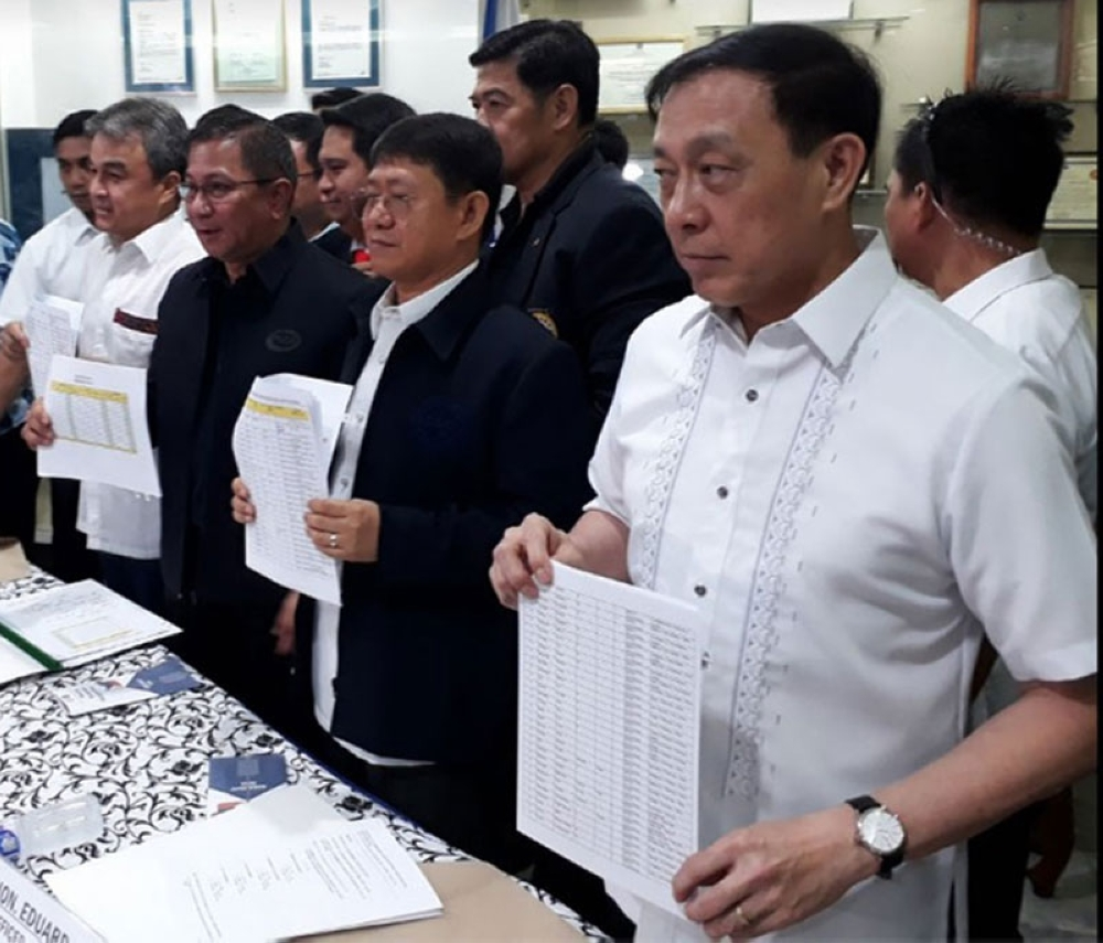 MANILA, In this file photo taken in April 2018, authorities present a watchlist containing the names of at least 90 barangay chairmen who were allegedly involved in the illegal drugs trade. (File Photo)