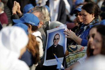 VATICAN. A woman holds a picture of martyred Salvadoran Archbishop Oscar Romero prior to a canonization ceremony in St. Peter's Square at the Vatican, Sunday, Oct. 14, 2018. Pope Francis canonizes two of the most important and contested figures of the 20th-century Catholic Church, declaring Pope Paul VI and the martyred Salvadoran Archbishop Oscar Romero as models of saintliness for the faithful today. (AP Photo)