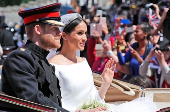 ENGLAND. In this file photo dated May 19, 2018, Britain's Prince Harry and his bride Meghan Markle, ride in a carriage after their wedding ceremony at St. George's Chapel in Windsor Castle in Windsor, near London, England. (AP)