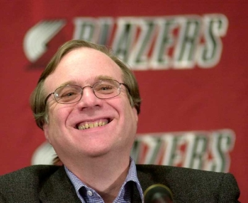 In this Feb. 10, 2004, file photo, Portland Trail Blazers owner Paul Allen smiles as he talks to the media at the Rose Garden arena during halftime of the Blazers game against the Utah Jazz in Portland, Ore. Allen, billionaire owner of the Portland Trail Blazers and the Seattle Seahawks and Microsoft co-founder, died Monday, Oct. 15, 2018 at age 65. (AP)
