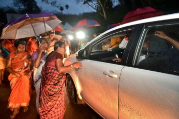 INDIA. Hindu women favoring barring women of menstruating age from entering the Sabarimala temple scan vehicles at Nilackal, a base camp on way to the mountain shrine in Kerala, India, Tuesday, October 16, 2018. (AP)