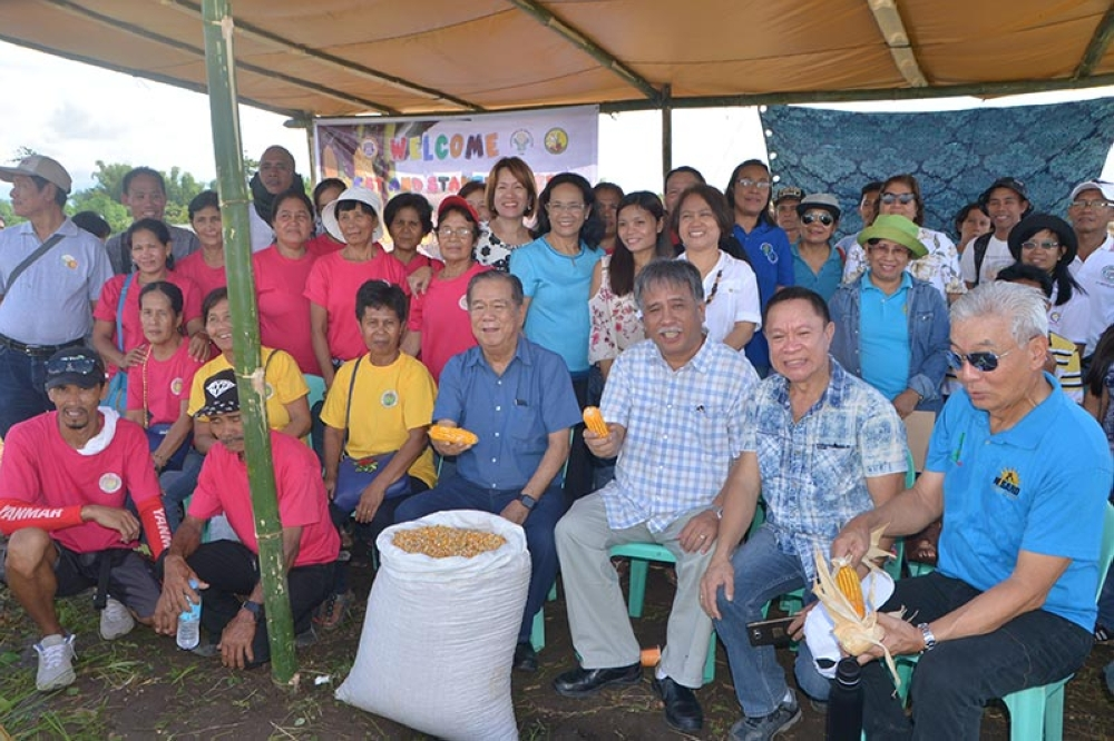 Negros Occidental Governor Alfredo Marañon Jr. (seated, fourthfrom right), along with other officials and farmers, during the Corn Field Day and Harvest Festival held at the Demo Farm in Paglaum Village, Bacolod City Wednesday. (Contributed Photo)
