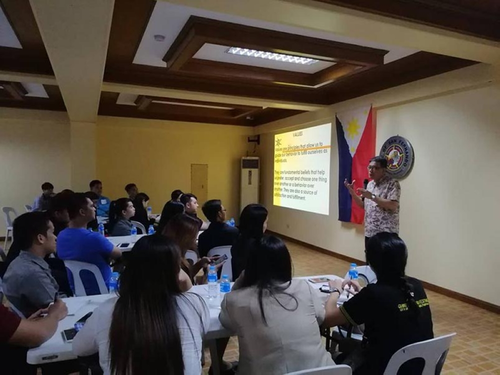"""PAMPANGA. Resource Speaker Carlos """"Charlie"""" Garcia Jr. discusses the values of service excellence in tourism to frontliners during the seminar at Heroes Hall on Tuesday, October 16, 2018. (Photo by Nicole Renee David)"""