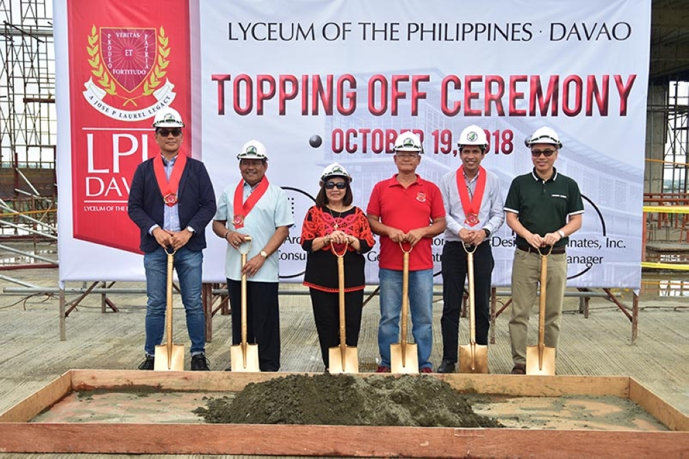 TOPPING OFF. From left, Franz Zeibert, Engineer Nemesio Jardeleza, Davao City Councilor Pilar Braga, Lyceum of the Philippines-Davao Vice President and Chief Academic Officer Dr. Felipe Balingit Jr., Architect Jim Abaloyan, and Micheal Espiritu during the topping off ceremony on Friday, October 19, at the Lyceum of the Philippines-Davao campus in KM.11 Diversion Road, Sasa, Davao City. (Macky Lim)