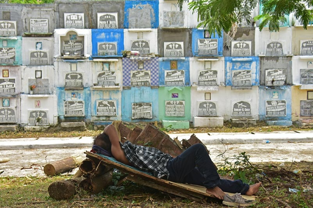 DAVAO. A man takes a nap after their morning work inside the Wireless Public Cemetery in Barangay 8-A, Davao City as they prepare the cemetery for the upcoming All Souls and All Saints Day next month. (Macky Lim)