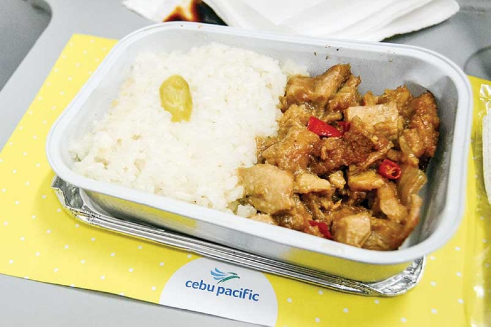 Cebu Pacific's Chicken Sisig was a delightful meal during our Manila-Denpasar flight. The dish is among the new set of pre-order meals of Cebu Pacific. (Reuel John F. Lumawag and Joros Razon)
