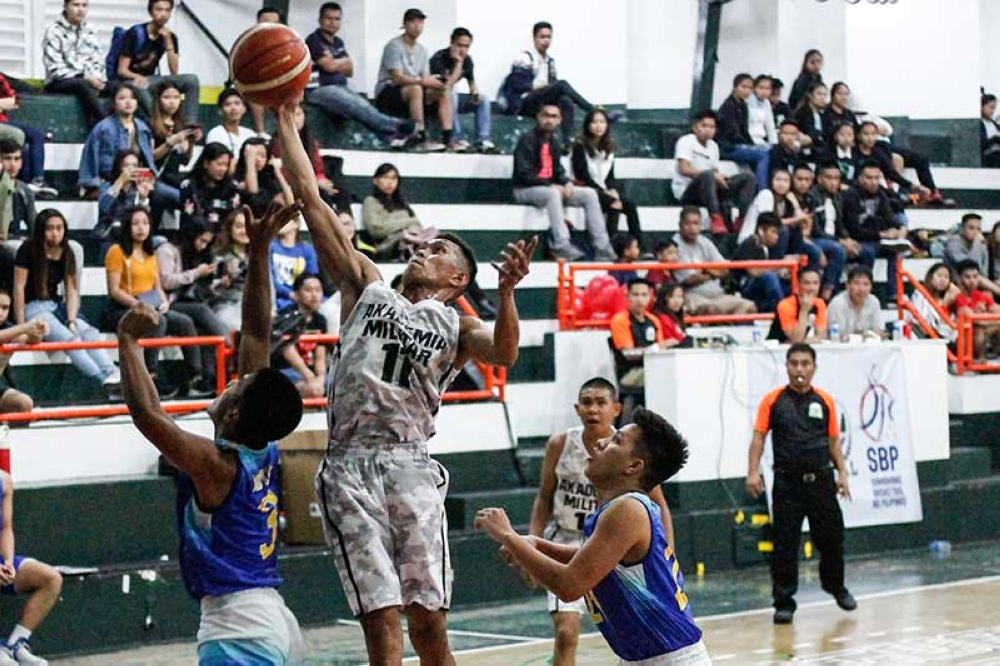 BAGUIO. The most awaited Baguio-Benguet Educational Athletic League (BBEAL) season 32 men's basketball games kicked off on October 20 at the University of the Cordilleras (UC) gymnasium with Philippine Military Academy stunning Saint Louis University. (Photo by Jean Nicole Cortes)