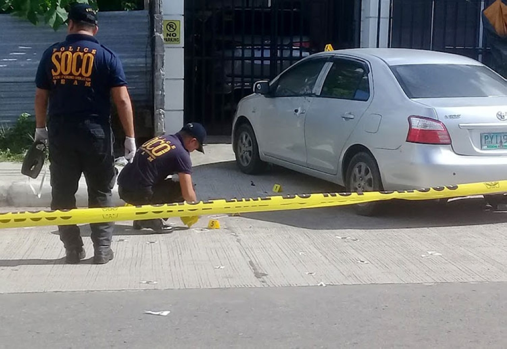 LEYTE. Police investigate the ambush of Police Senior Inspector Jovel Young, 39, outside his house on Tuesday, October 22, in Barangay Buri, Palo, Leyte. (Ronald Reyes/Sunstar Philippines)