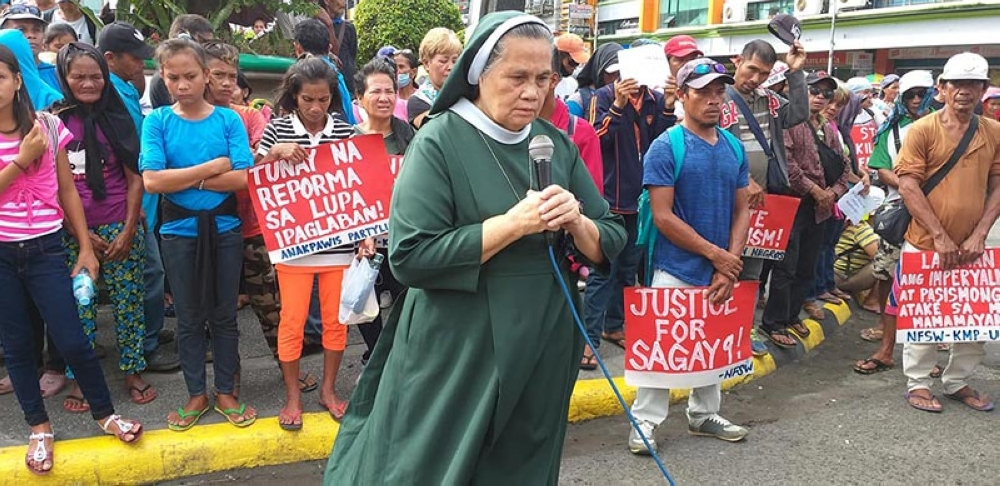 BACOLOD. Militant groups and various sector in Negros Occidental are calling for justice for the victims, whom they called the Sagay 9, in a rally at the Fountain of Justice in Bacolod City, Monday, October 22. (Erwin Nicavera)