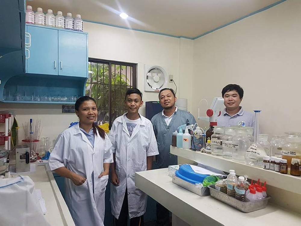 Provincial Feed and Meat Laboratory Section Head Dr. Merie Ann Tolentino (left) and other personnel with Chris Bastian Gabana (second from left), a Grade 10 student of Dr. Vicente F. Gustilo Memorial National High School in Cadiz City, doing a research at the PVO facility recently. (Contributed Photo)