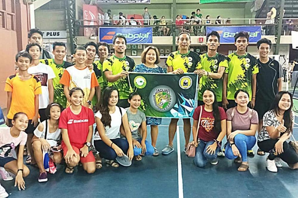 North Negros College celebrates their six-peat title in the Nopsscea badminton tournament. (Jordan Sun)