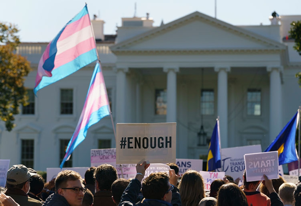 USA. The National Center for Transgender Equality (NCTE) and the Human Rights Campaign gather on Pennsylvania Avenue in front of the White House in Washington, Monday, October 22, 2018, for a #WontBeErased rally. (AP)