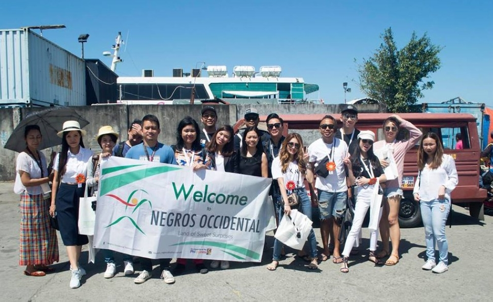 BACOLOD. Negros Occidental Tourism Division personnel led by Supervising Tourism Operations Officer Cristine Mansinares (6thfrom right) welcome the press and social media influencers from Malaysia, who will have their six-day experiential tourism tour in the province, at the Bredco Port in Bacolod City on Wednesday. (Contributed photo)