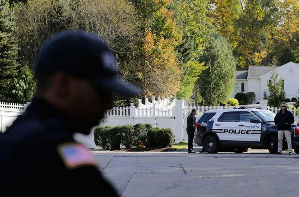 NEW YORK. Police officers stand in front of property owned by former Secretary of State Hillary Clinton and former President Bill Clinton in Chappaqua, N.Y., Wednesday, Oct. 24, 2018. A US official says a
