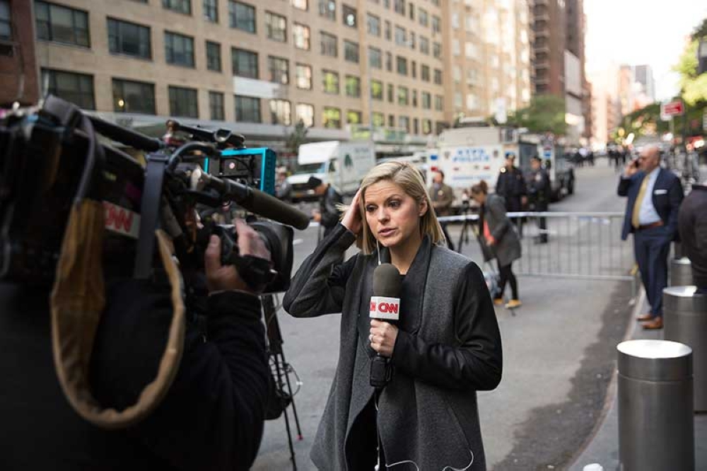NEW YORK. CNN correspondent Kate Bolduan reports from in front of the Time Warner Building, where NYPD personnel removed an explosive device Wednesday, Oct. 24, 2018, in New York. Other packages were sent to the offices of Gov. Andrew Cuomo and to the home of President Bill Clinton. (AP)