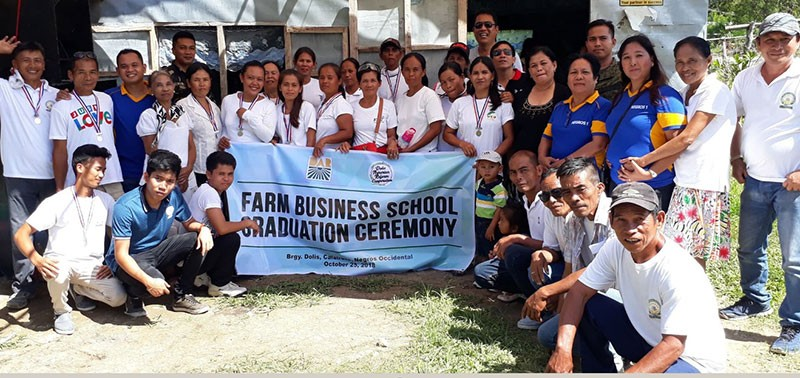 CALATRAVA. CRFPS division chief Agnes Callantas (standing, 5th from right), Municipal Agrarian Reform Program Officer Julieta Mangao (standing, 6th from right), and municipal government representative Junrey Cardiente (7th from right) with the ARB-graduates of the Farm Business School program in rites held in Calatrava town on Thursday. (Contributed Photo)