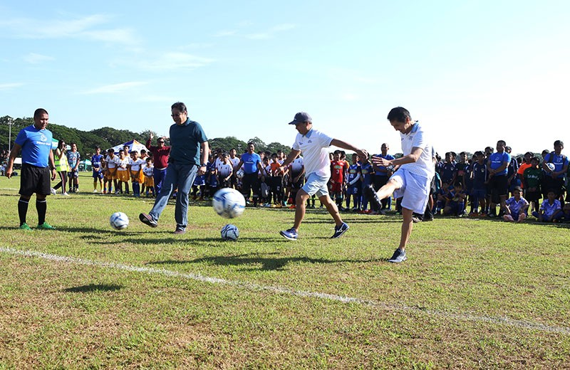 PAMPANGA. Clark Development Corporation president and CEO Noel Manankil with Bases Conversion and Development Authority President and CEO Vivencio Dizon and Manila Soccer Academy director and head organizer of Pinas Cup Monty Roxas lead the ceremonial kick-off of the Pinas Cup 2018 at Clark Parade Grounds. (Photo by CDC-CommDep)