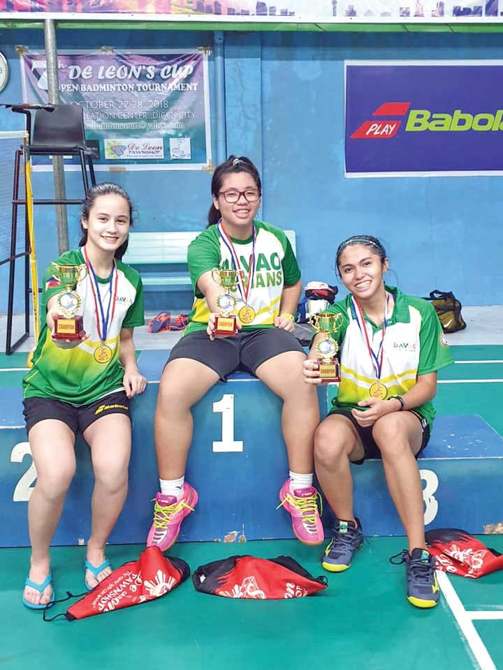 From left, Davao City shuttlers Cheska Almazan, Julia Arendain and Karylle Kaye Molina hold their trophies at the close of the 7th De Leon's Cup Badminton Tournament held at the BStar Recreation Hall in Digos City over the weekend. (Contributed photo)